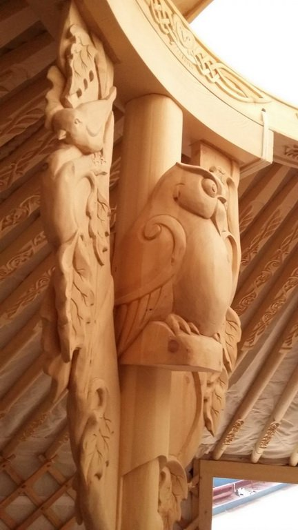 yurt with carved owl