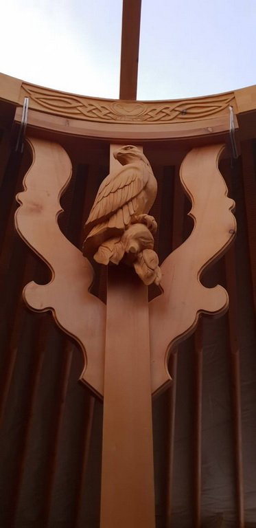yurt with carved eagle